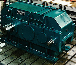 A green gearbox used for industrial equipment.