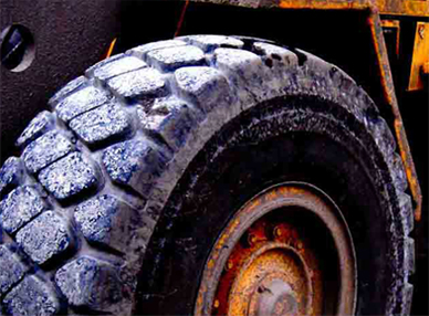 A close view of a rubber tire.