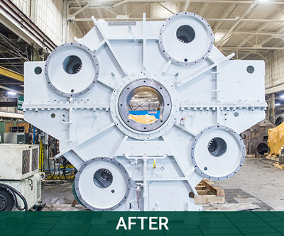 A large, silver-colored, steel BOF gear drive that has been repaired and cleaned by Horsburgh & Scott.