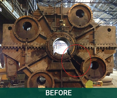 A heavy-duty, rust-colored steel BOF gear drive in Horsburgh & Scott's facility before it was repaired.