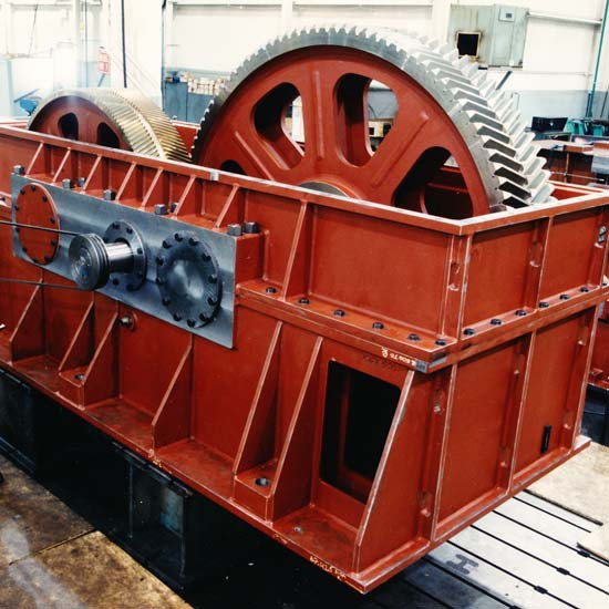 A large, red-colored gearbox for sugar processing applications.